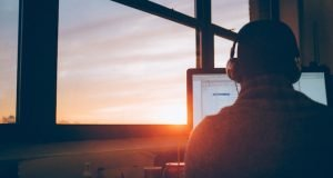 Man working on computer at dawn - What is Self Employment ? - Which Type is Best