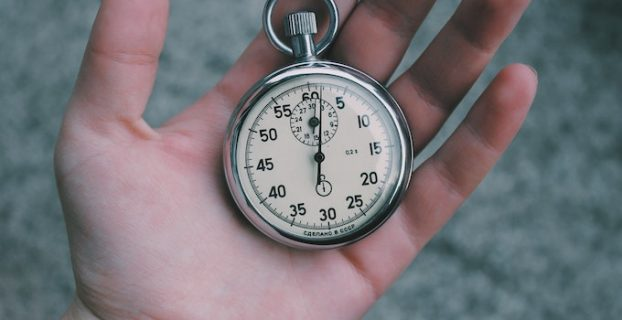 Stopwatch in persons hand - Why Website speed is important