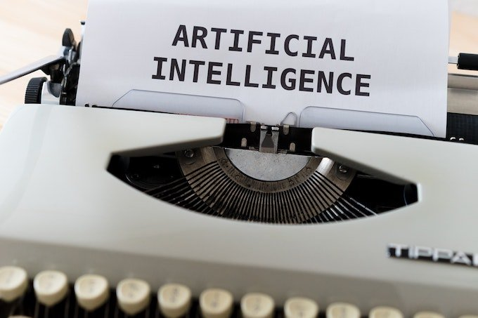 artificial intelligence typed on piece of paper in typewriter