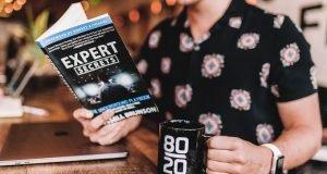 Man reading book on expert secrets