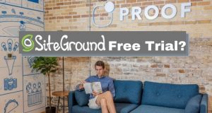 man sitting on couch reading - Siteground Free Trial