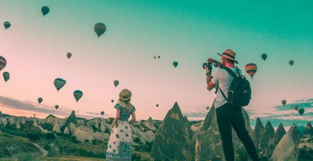 man taking photos of balloons - travel